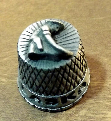 Alaska pewter thimble Top is a gold miner panning for gold in hi-relief