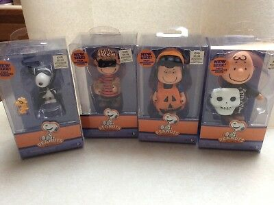 Four  different peanuts Halloween poseable figures