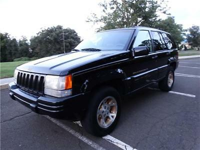 Grand Cherokee Limited 1998 Jeep Grand Cherokee Limited 4X4 BLACK ON BLACK SUV LOADED NO RESERVE