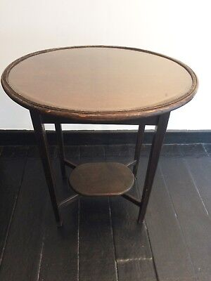 Antique dark oak wooden side table with oval shaped inlaid glass top