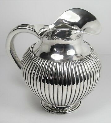 Jug very beautiful solid silver relief work – very good condition