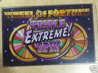 IGT Wheel of Fortune sign, slot machine plexiglass sign. W.O.F. Tri Extreme Spin