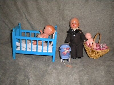Lot of vintage doll house dolls and crib basket and buggy