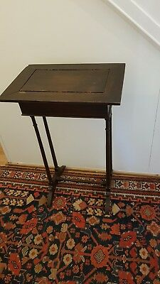 An Edwardian Occasional Table With Lift Up Top