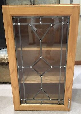 """Oak Wall Cabinet With Leaded Glass Door. 18"""" Wide. Pickup Only."""