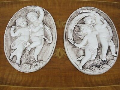 Rare Pair of Vintage Capodimonte Wall Art Playing Cherub Bas Relief Oval Plaques