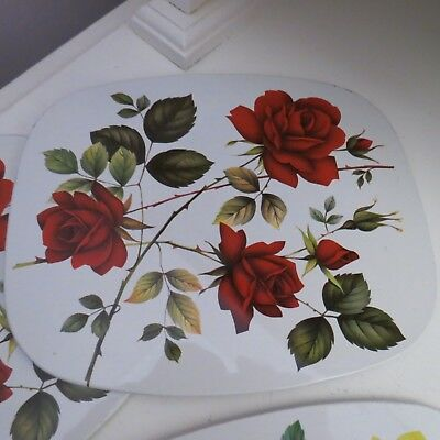 Fabulous vintage place mats with tin metal top cork base featuring roses England