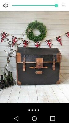 Vintage leather bound, dome top steamer trunk