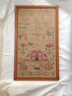 Sampler from 1808 with house
