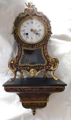 french striking boulle clock with wall  bracket