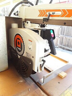 Maggie  radial arm saw With Woodman Group In-feed and  Out-feed Rollers.