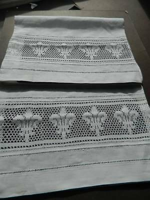 Stunning antique white Irish linen pillowcases with crochet lace inserts.