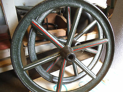 Two nicely repainted antique cast iron tractor wheels, in a lovely condition.