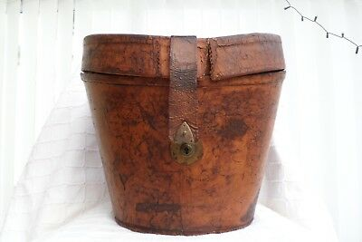 Vintage old victorian edwardian leather top hat box with patina and red interior