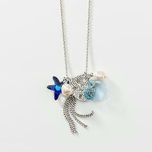 Touchstone Crystal by Swarovski Sand Dollar Tassel Necklace