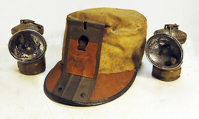 Coal miner's cloth cap and 2 brass carbide lamps, early 20th century
