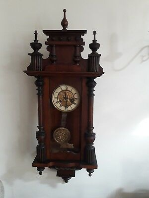 Antique  wall clock with pendulum  and chimes. Full working order.