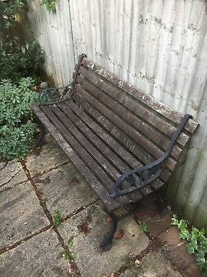 Vintage Garden Bench with Wooden Slats and Cast Iron Supports