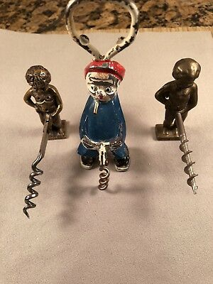 Antique figural corkscrews - group of three