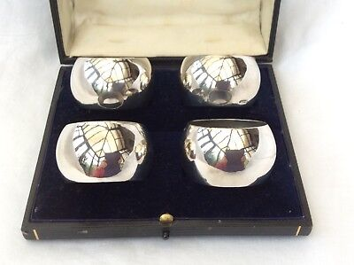 CASED SET OF FOUR SILVER NAPKIN RINGS - no engraving.