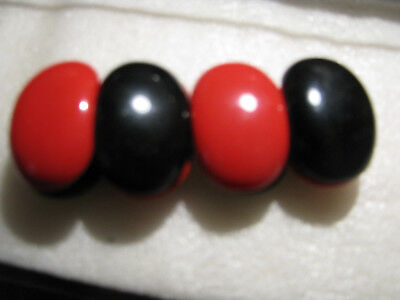 """Vintage 7"""" Stretch Bracelet With Black And Red Thermoset Oval Pieces"""