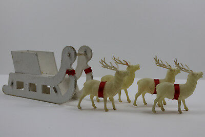 Four 1950's Vintage Celluloid Reindeer with Sleigh