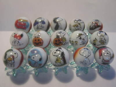 snoopy from the peanuts gang 5/8 size glass marbles + stands