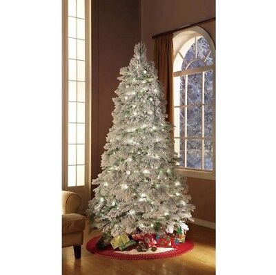 flocked christmas tree pre lit 75 ft with stand 450 clear lights indoor holiday