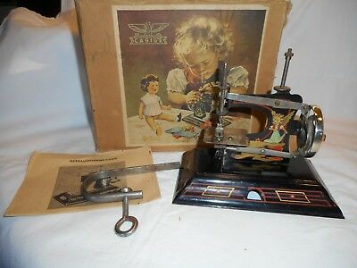 Antique CASIGE Child's Metal Toy Sewing Machine Made In Germany Girl & Dog & Boy