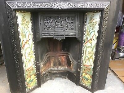 Cast Iron Tiled Fireplace with Attractive Bird Design