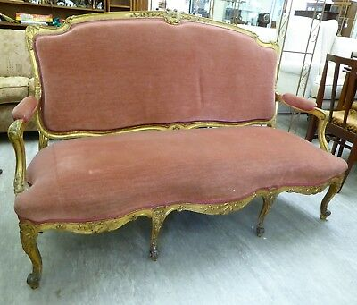 Nineteenth Century antique French Louis style salon sofa with carved gilt frame