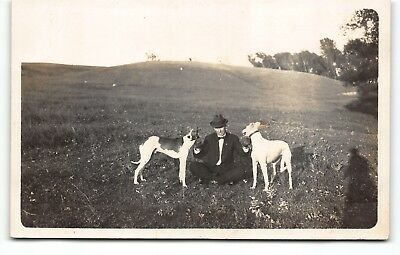 Man with Greyhound Dogs who want to RUN! RPPC Real Photo AZO Postcard