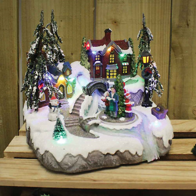 Snowy Christmas Carol Singers Village Scene LED With Lights & Sound