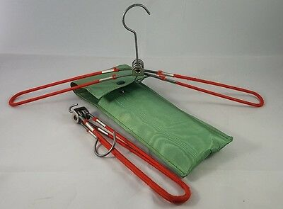 A pair of vintage travel clothes hangers