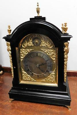 winterhalder & hoffmeir ebonised and brass cased 1/4 strike bracket clock