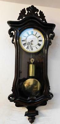 intresting early style of dwarf rosewood cased vienna single weight wall clock