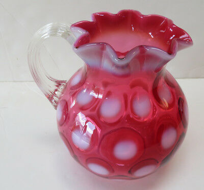 Cranberry & opalescent Coin spot pitcher applied rib handle