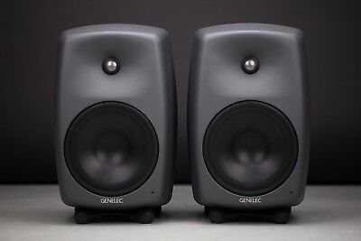 Genelec 8050A pair of monitor speakers with matching numbers and manuals.
