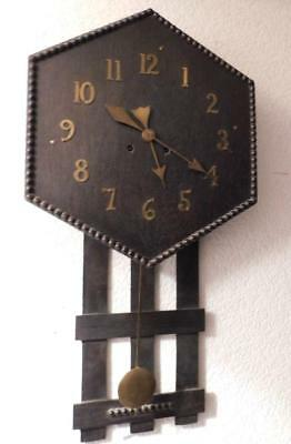arts and crafts style striking wall clock
