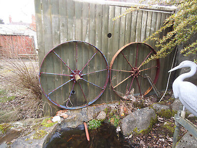 Two large antique metal wagon wheels