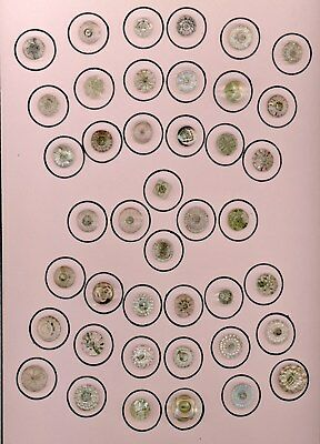 9 x 12 card of 42 mainly small antique clear glass buttons.