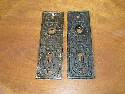 Pair of Ornate Antique Victorian Cast Iron Door Knob Backplates with Keyhole