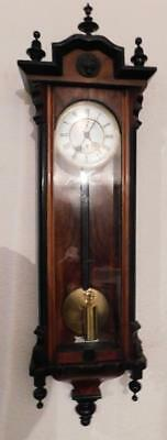 walnut & ebonised single weight vienna wall clock