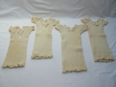 Vintage wool new born baby or doll vests x4 unsold old shop stock