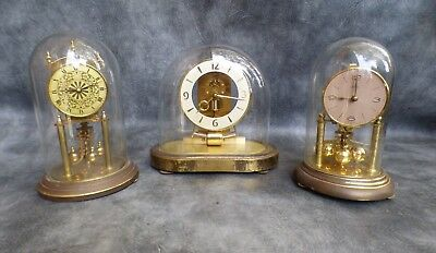 Two Anniversary Clocks And A Kieninger Electronic Clock For Repair