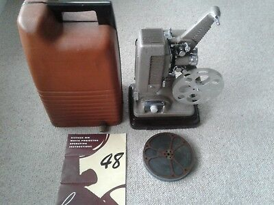 Revere, model 48, 16mm Projector w case and 1943 Football Film by Castle