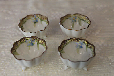 4 Porcelain Footed Open Salt Dishes With Hand Painted Blue Flower