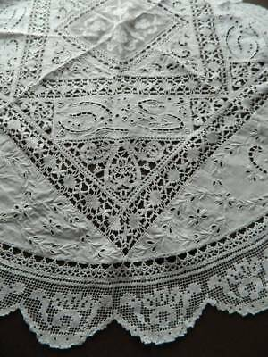 Superb white circular Irish linen tablecloth with hand embroidery & filet lace.