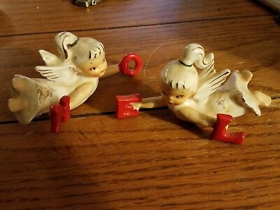Pair of Lefton Noel Angel candle hugger climbers