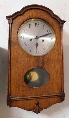 small 8 day oak cased wall clock by hac germany